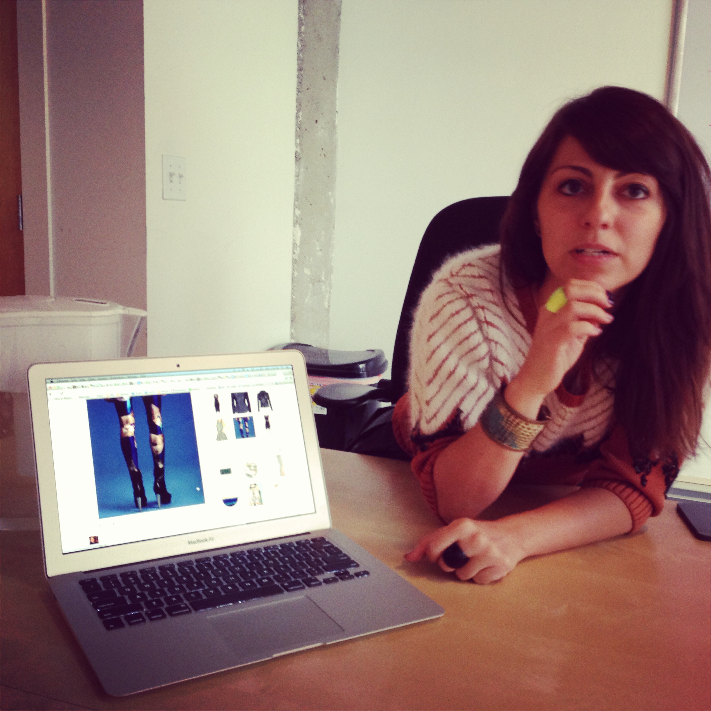 Wanelo CEO Deena Varshavskaya in the company's SOMA offices, showing off her recent Wanelo find -- cat-themed leggings.