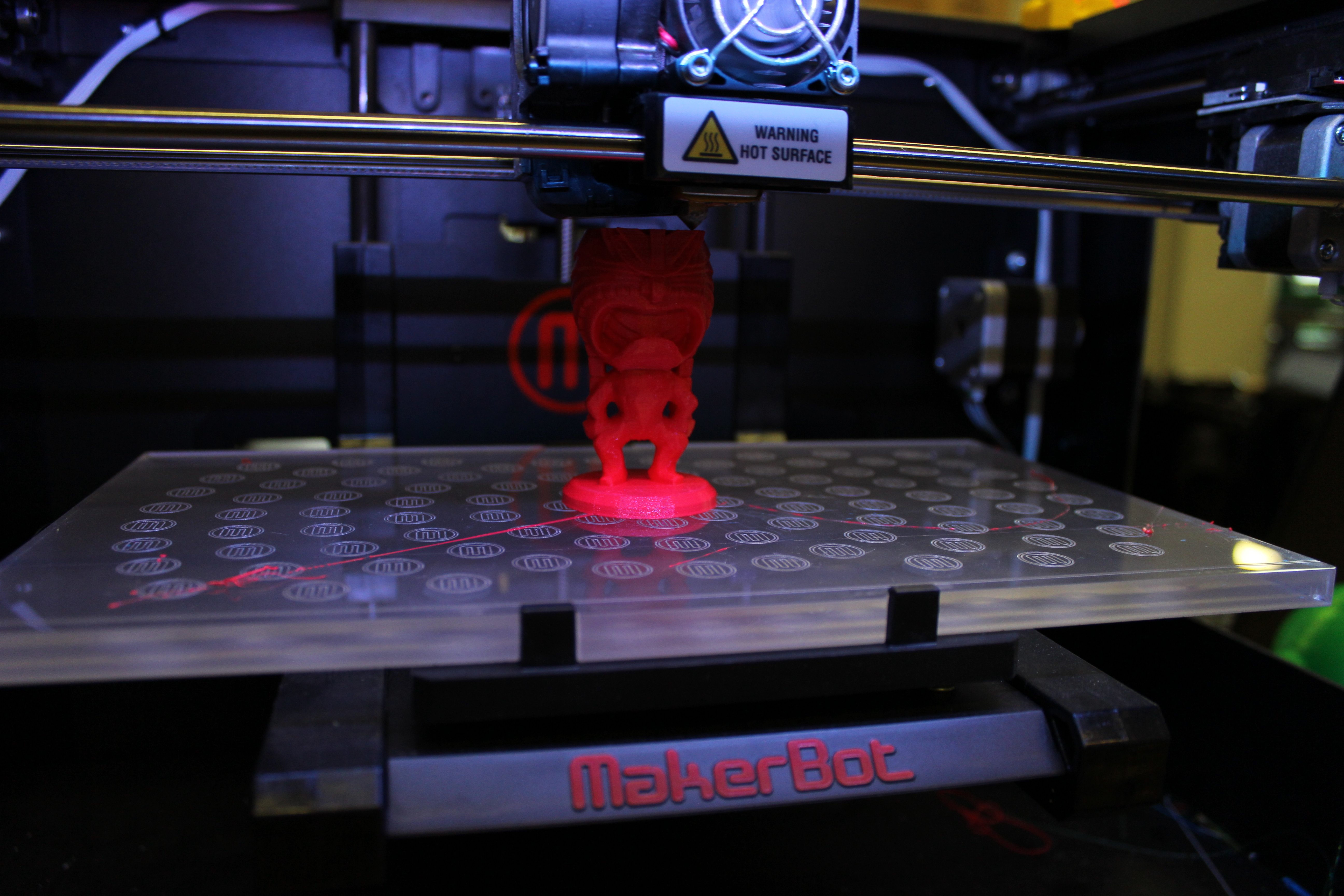 Workers produce desktop printers that can create small plastic prototypes.