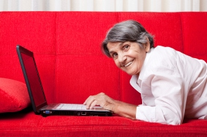 old woman using laptop