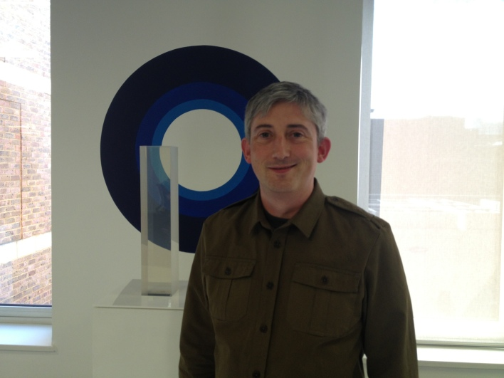 ODI CEO Gavin Starks, in front of art in the ODI offices in Shoreditch.