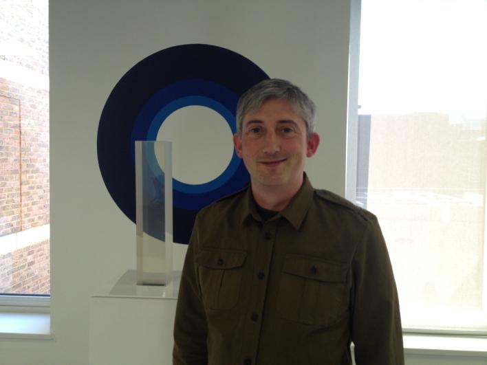 ODI CEO Gavin Starks, in front of art in the ODI offices in Shoreditch.
