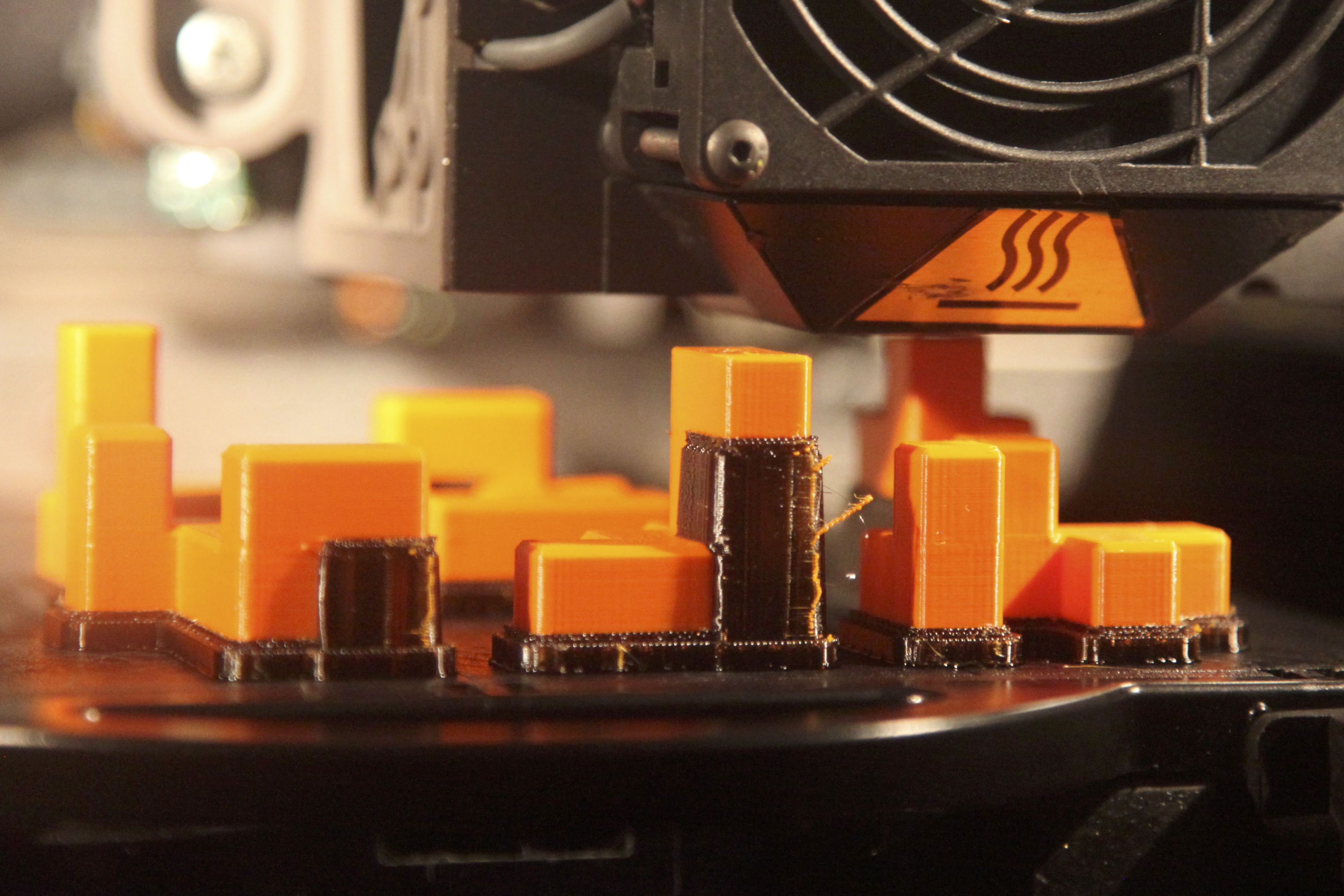 George Miller's Stratasys Dimension 3D printer prints pieces for a cube puzzle. Photo by Signe Brewster