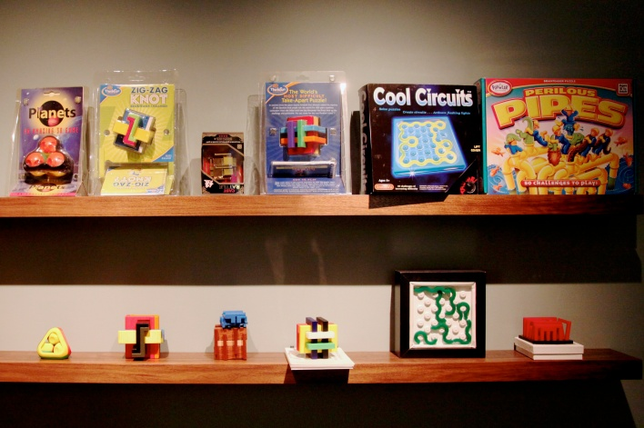 George Miller has brought many of his puzzle creations to market. In his San Francisco home, he displays many of the original prototypes and the finished, packaged version. Photo by Signe Brewster