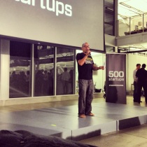 Dave McClure introduces a startup at the demo day on July 25, 2013, in San Francisco.
