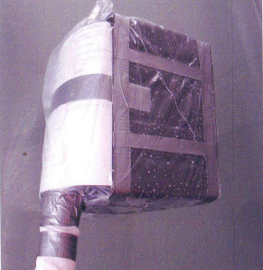 A replica of the jury-rigged Apollo 13 filter shows the paper, plastic and tape that went into its modification.