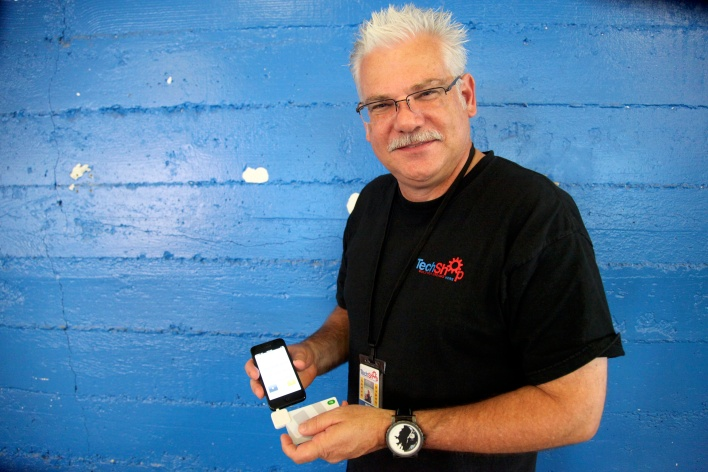 TechShop CEO Mark Hatch poses with a modern Square reader. Photo by Signe Brewster