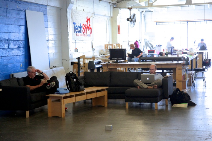 CEO Mark Hatch and members work on the top floor of TechShop. Photo by Signe Brewster
