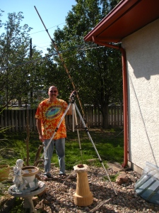 Mike Coletta poses in his yard in Pueblo, Col., with his 12 element yagi antenna he built from metal coat hangers and wood. Photo courtesy of Mike Coletta