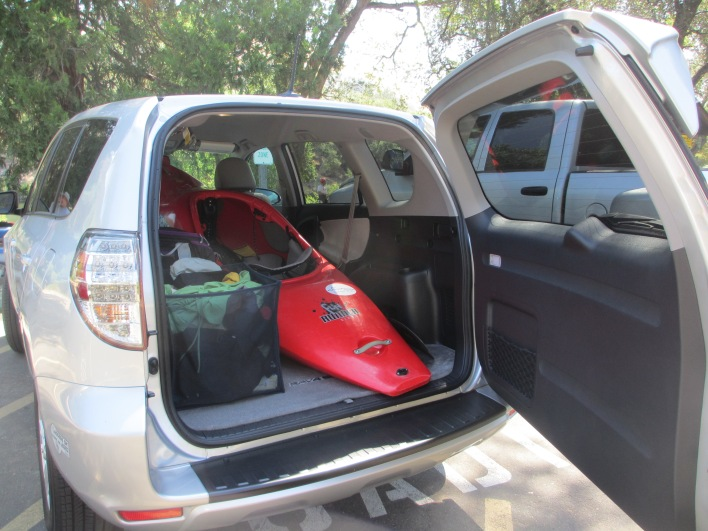 The electric RAV4 makes it easy to transport my kayak and gear to the American River.