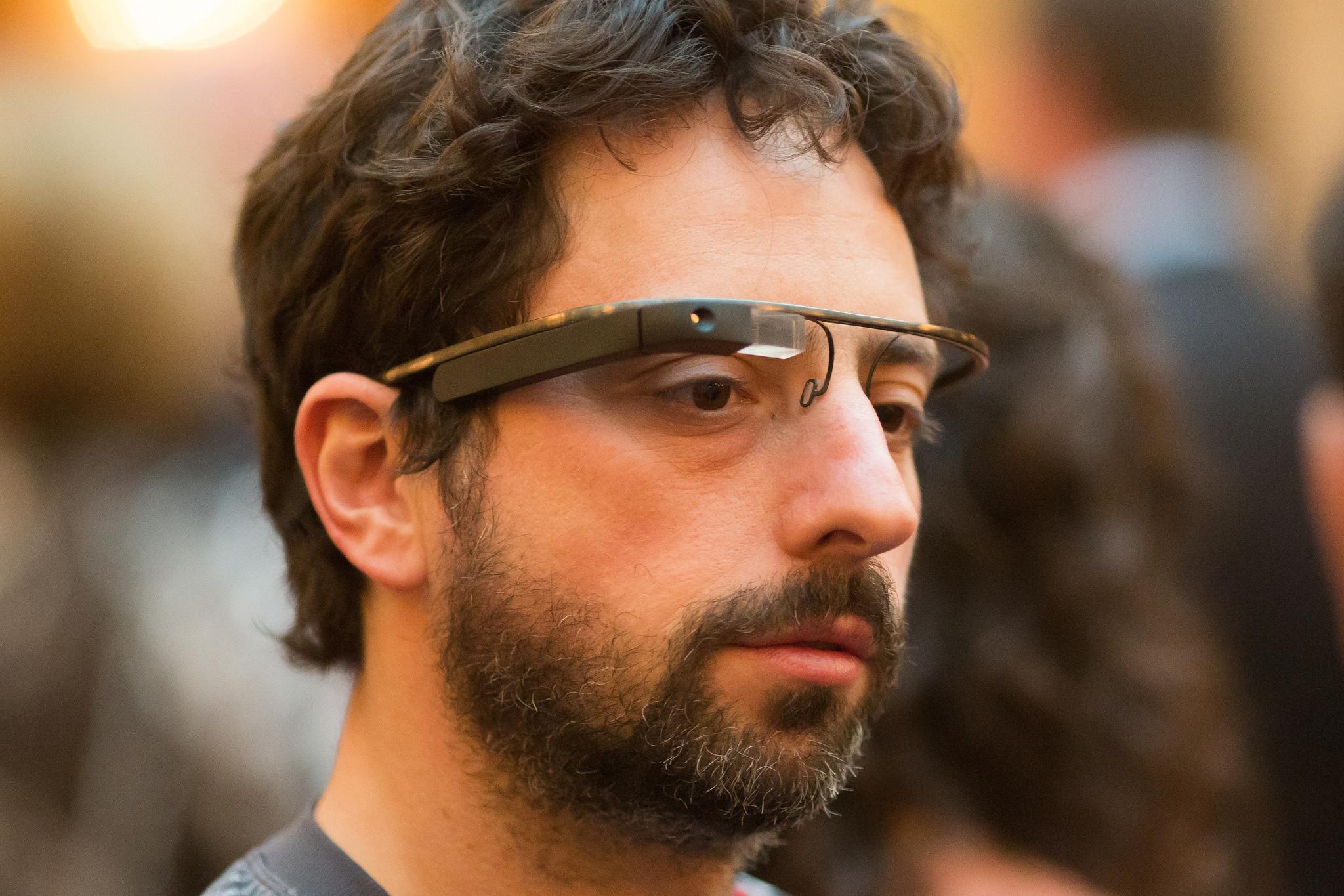 Google cofounder Sergey Brin sports his ever present Google Glass.