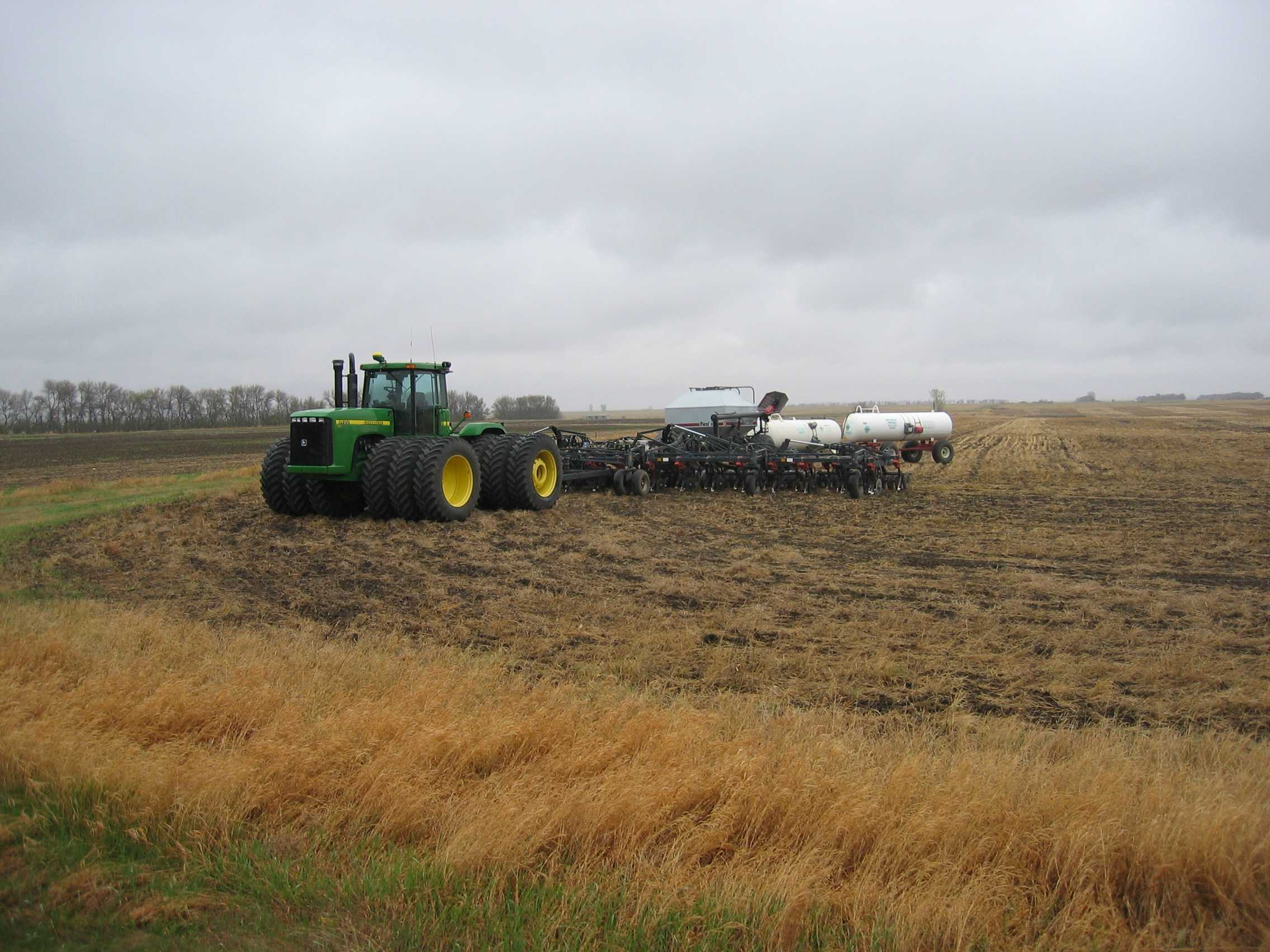 The tractor on the Dible farm, similar to this one, represents a capital investment of almost one million dollars.