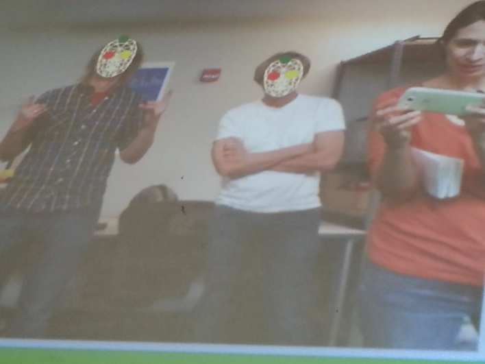Those aren't Halloween masks, it's how the computer sees the frog designers' faces to see if they are looking at it.