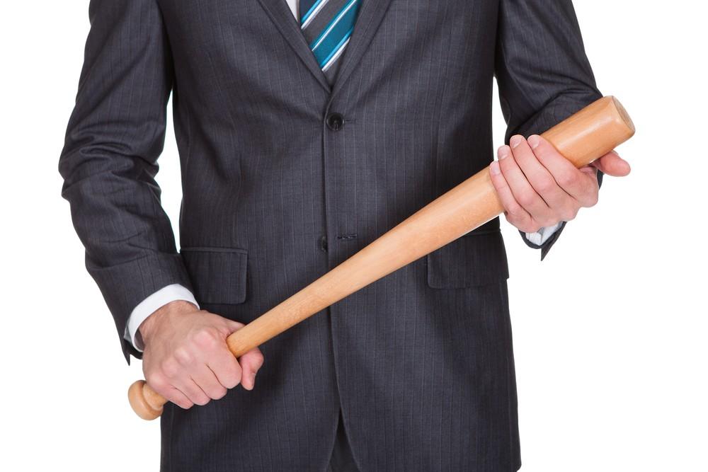 Big stick: bat and business suit