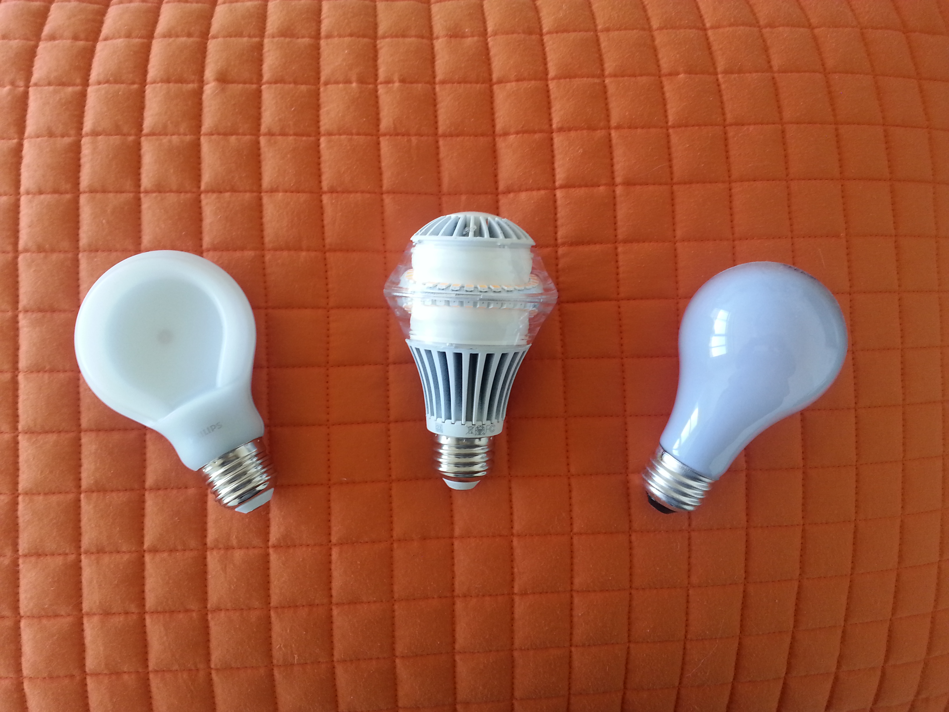 From left to right: The Philips SlimStyle, an LED with heat sink and a traditional 60-watt bulb.