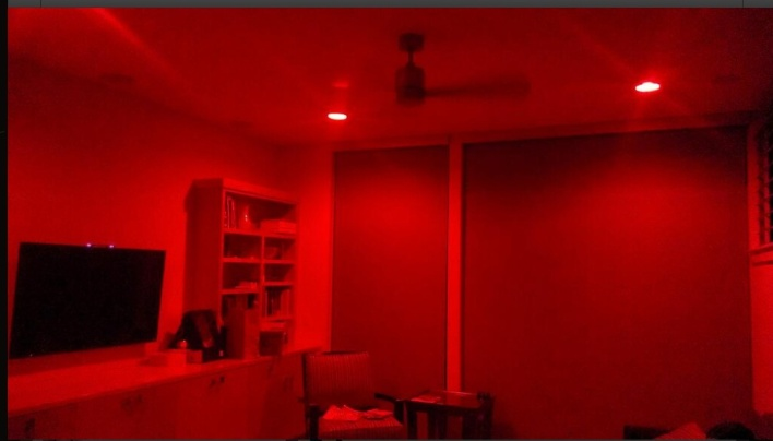 My living room after the Cardinals scored a point during the World Series. The Hue lights turned red.