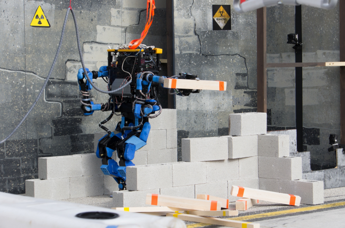 SCHAFT moves debris at the December trials. Photo courtesy of DARPA.