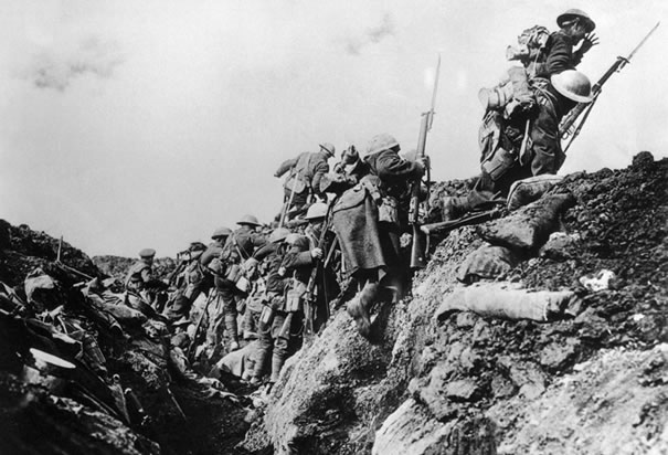 canadian-soldiers-going-over-trench