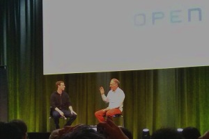Mark Zuckerberg (hoodie) on stage with Tim O'Reilly.