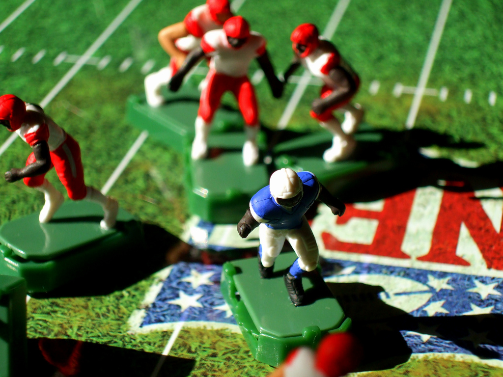 A real game isn't quite as random as electronic football, but it's close. Source: Flickr / John-Morgan