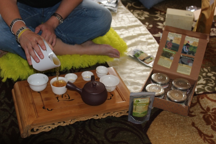 Petersen pouring tea on Tealet's traveling tea party mat.