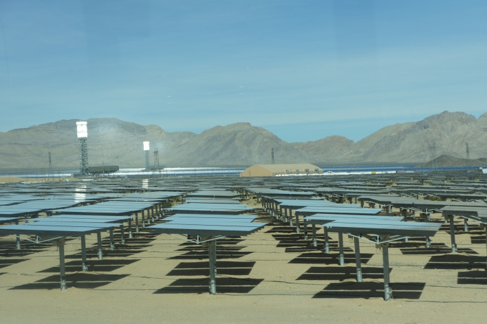 Ivanpah's heliostats with two towers in background.