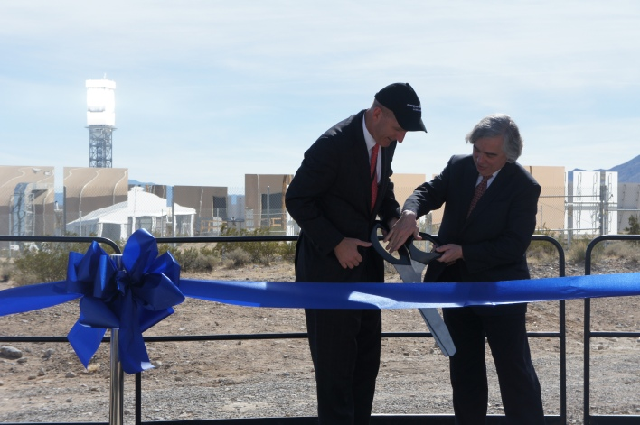 NRG Energy CEO David Crane and Energy Secretary Ernie Monitz cutting the ribbon at solar farm Ivanpah, just outside of Las Vegas