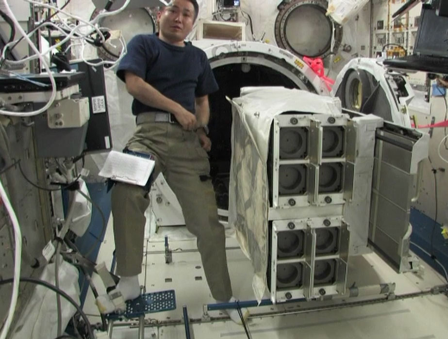 Astronaut Koichi Wakata, floating beside the Nanoracks CubeSat deployer on the International Space Station. Photo courtesy of Nanoracks.