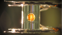 A metallic case called a hohlraum holds the fuel capsule for NIF experiments. Target handling systems precisely position the target and freeze it to cryogenic temperatures (18 kelvins, or -427 degrees Fahrenheit) so that a fusion reaction is more easily achieved.