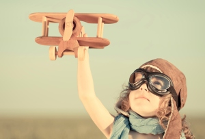 Child with toy plane
