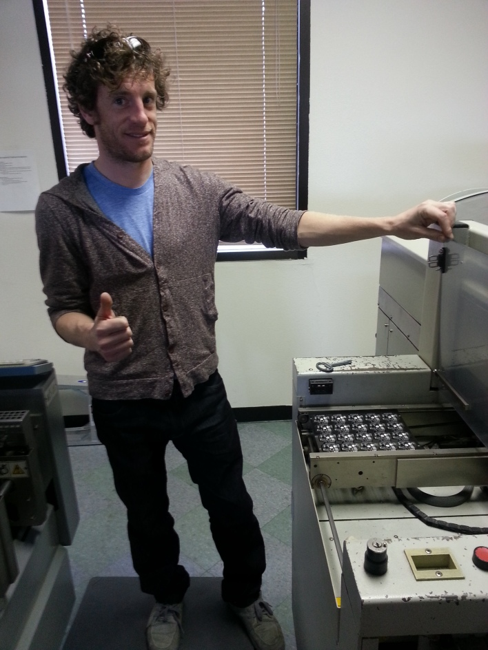 Modular Robotics CEO Eric Schweikardt standing next to the pick and place machine.