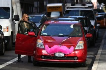 SAN FRANCISCO, CA - JANUARY 21: A Lyft customer gets into a car on January 21, 2014 in San Francisco, California. As ridesharing services like Lyft, Uber and Sidecar become more popular, the San Francisco Cab Driver Association is reporting that nearly one third of San Francisco's licensed taxi drivers have stopped driving taxis and have started to drive for the ridesharing services. (Photo by Justin Sullivan/Getty Images)
