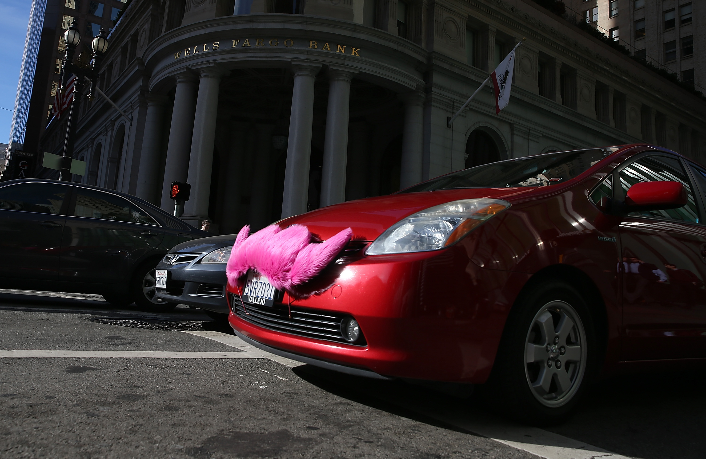 SAN FRANCISCO, CA - JANUARY 21: A Lyft car drives along Montgomery Street on January 21, 2014 in San Francisco, California. As ridesharing services like Lyft, Uber and Sidecar become more popular, the San Francisco Cab Driver Association is reporting that nearly one third of San Francisco's licensed taxi drivers have stopped driving taxis and have started to drive for the ridesharing services. (Photo by Justin Sullivan/Getty Images)