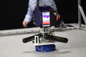 A NASA SPHERES robot equipped with a Google Project Tango phone. Photo by Signe Brewster.