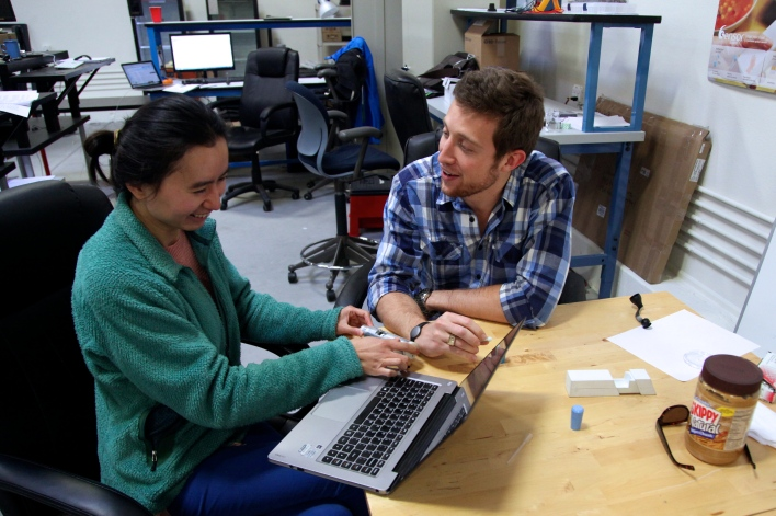 6SensorLabs lead scientist Jingqing Zhang and co-founder Scott Sundvor at Lemnos Labs. The white device in the middle of the table is a prototype of their gluten tester. Photo by Signe Brewster.