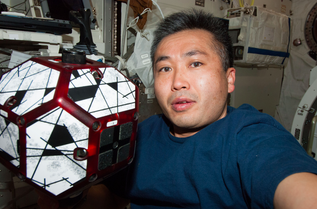 Astronaut Koichi Wakata aboard the ISS with a SPHERE robot. Photo courtesy of NASA.