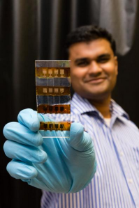 Nanyang Technological University assistant professor Nripan Mathews holds the NTU Perosvkite solar cell. Photo courtesy of Nanyang Technological University.