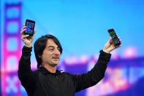 Joe Belfiore, corporate vice president and manager for Windows Phone, holds Windows phones as delivers a keynote address during the 2014 Microsoft Build developer conference on April 2, 2014 in San Francisco, Calif.  (Photo by Justin Sullivan/Getty Images)