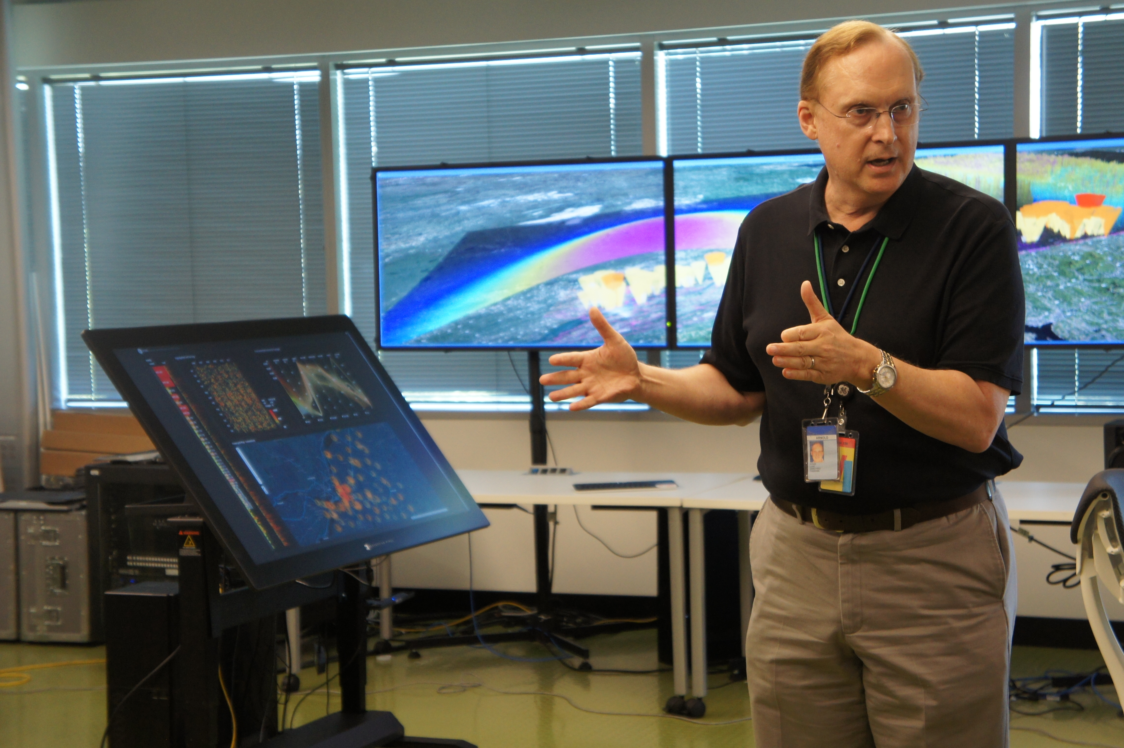 The manager of GE's UX Industrial Innovation Lab, Arnie Lund, shows off the lab.
