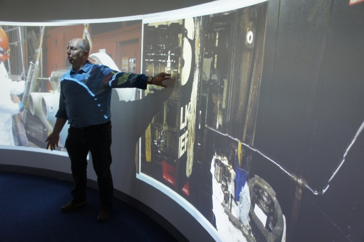 GE's user experience researcher David Gilmore shows off the immersive space