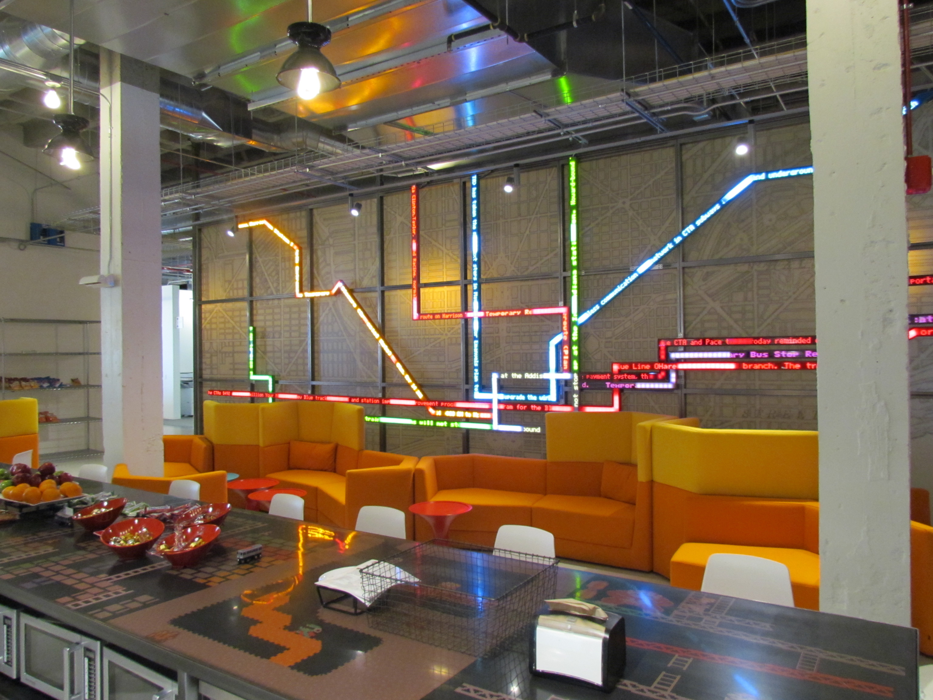 """A break room with Chicago's """"L"""" train map used as information display"""