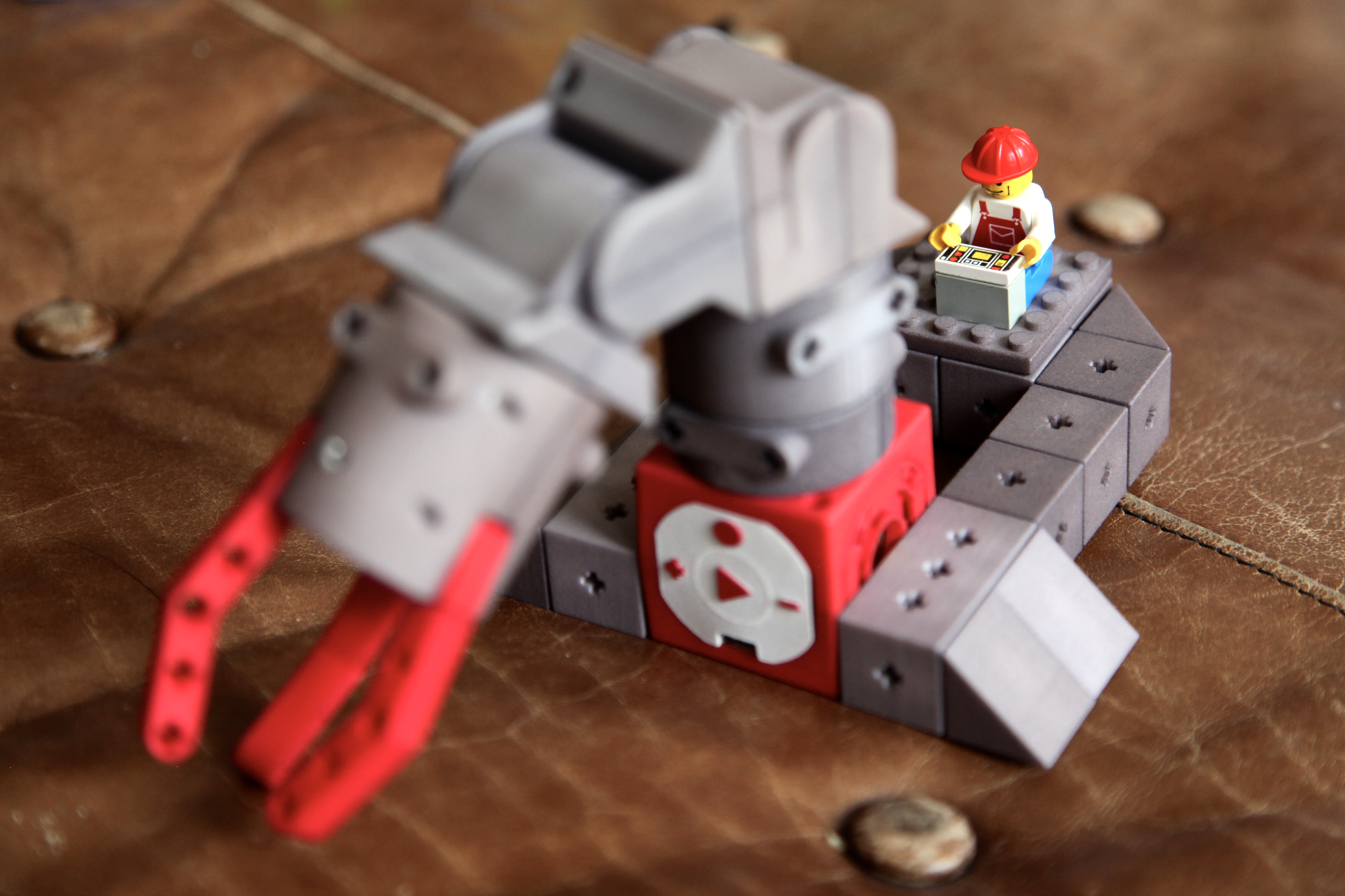 Adapter plates make TinkerBots compatible with Legos. Photo by Signe Brewster.