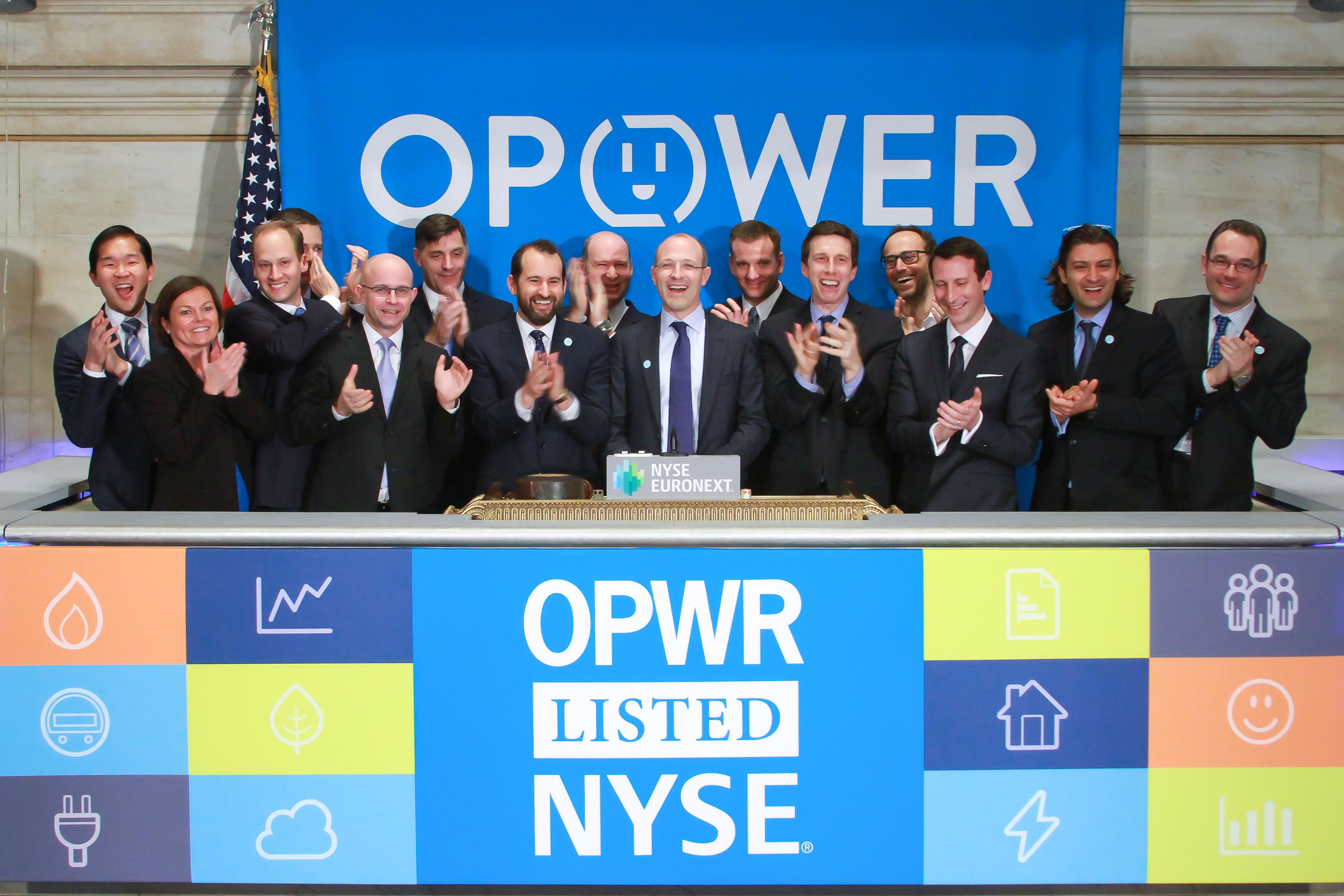 Opower executives at the New York Stock Exchange ringing the closing bell.