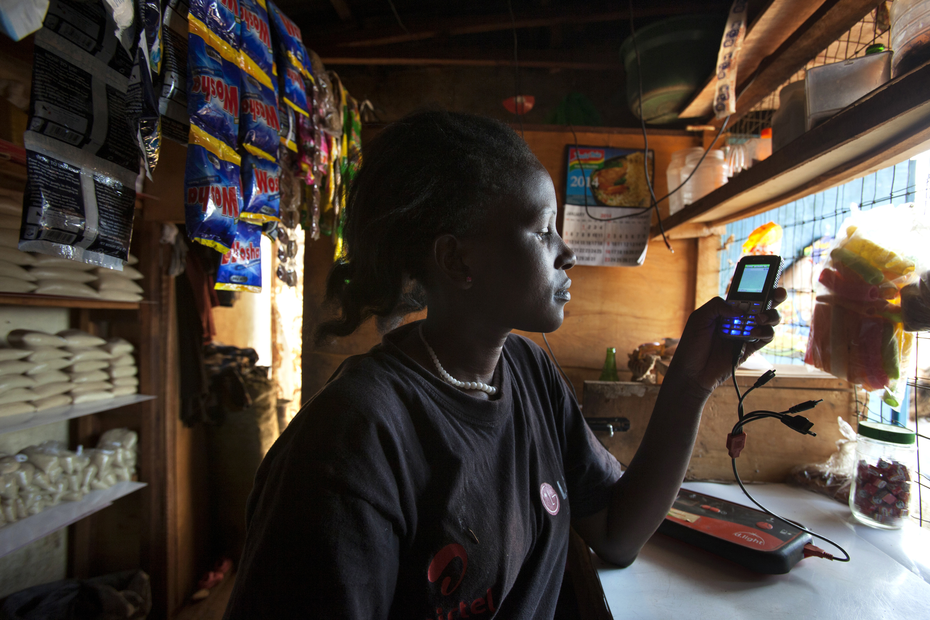 Cell phone charging via a solar system sold by M-KOPA.
