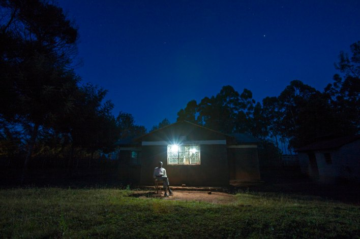 A home in Kenya, lit up by an M-KOPA solar system.