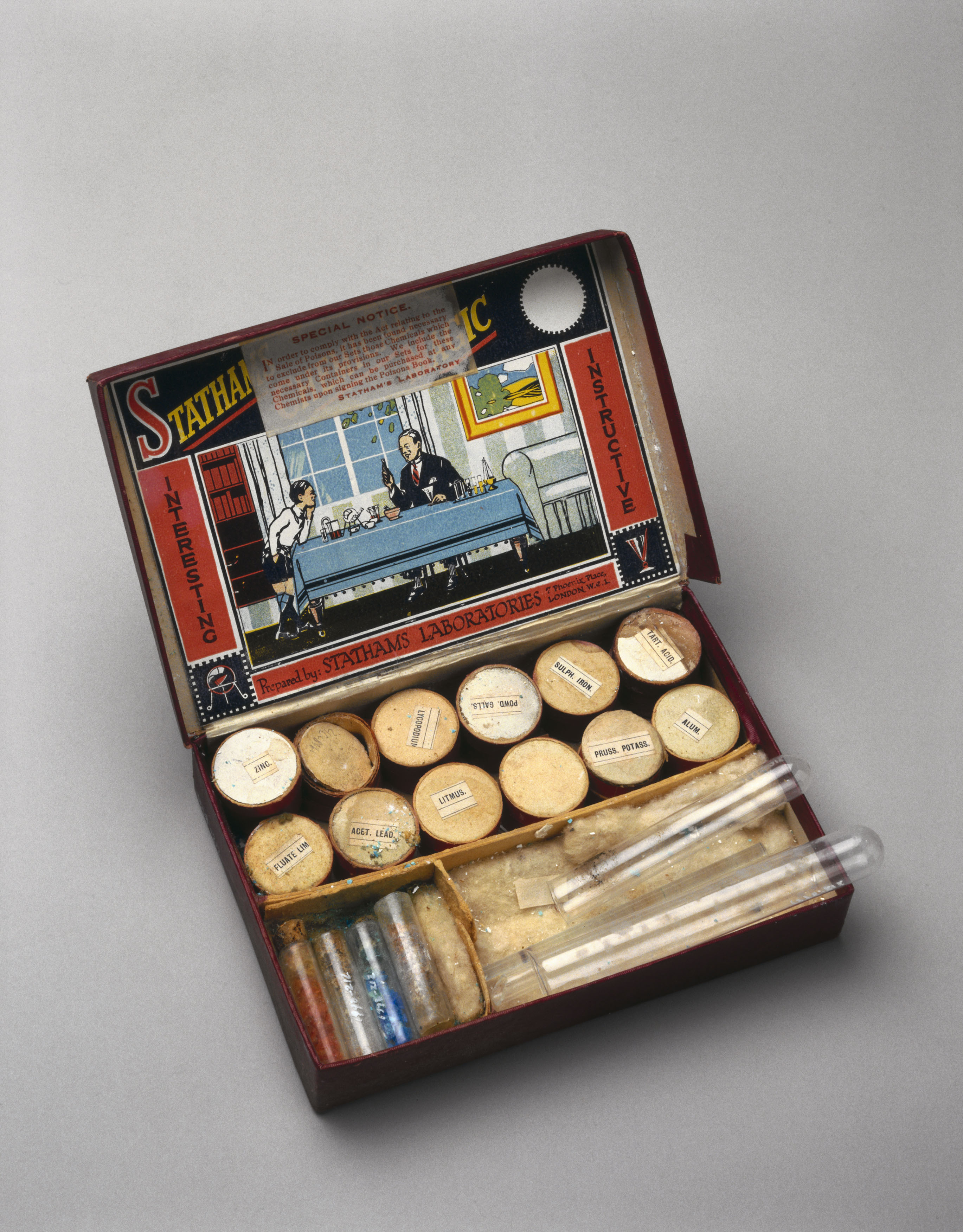 Stathams Chemical Magic chemistry set, c 1920-1940. The cardboard case contains instructions, chemicals and test tubes. The inside of the lid shows a picture of a father and son enjoying the kit.  (Photo by SSPL/Getty Images)