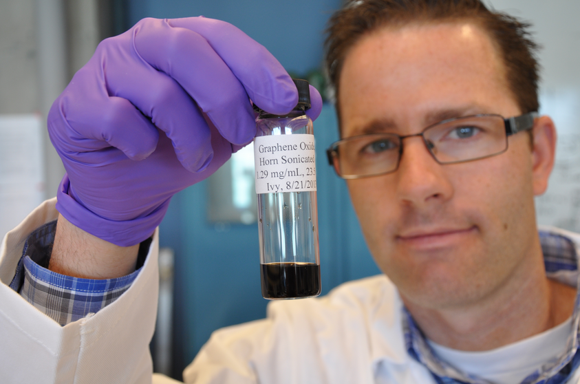 Paper co-author and PhD student Jacob D. Lanphere holds a vial of graphene oxide. Photo courtesy of the University of California-Riverside.