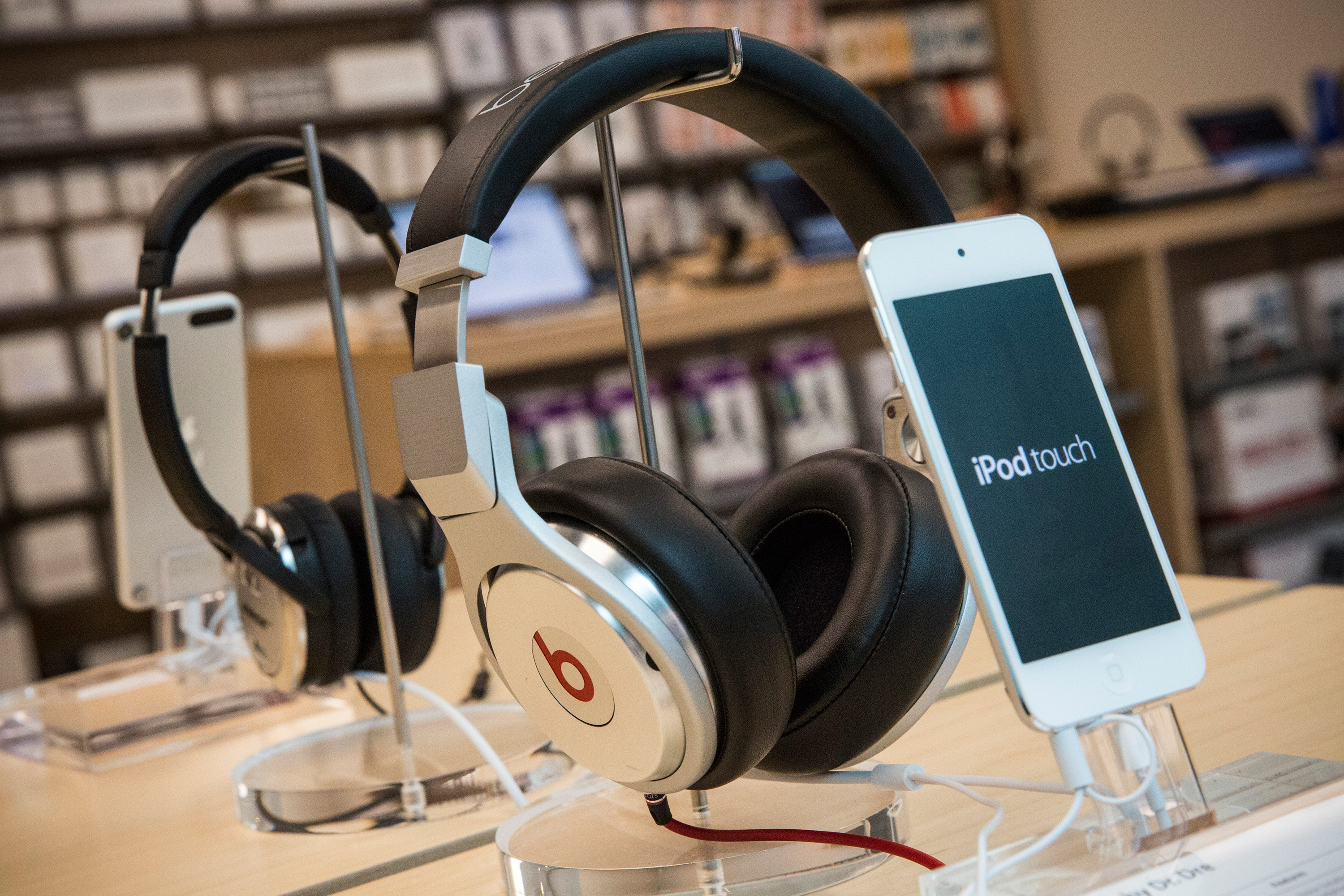 Beats headphones are sold along side iPods in an Apple store on May 9, 2014 in New York City. Apple is rumored to be consideringing buying the headphone company for $3.2 billion.  (Photo by Andrew Burton/Getty Images)