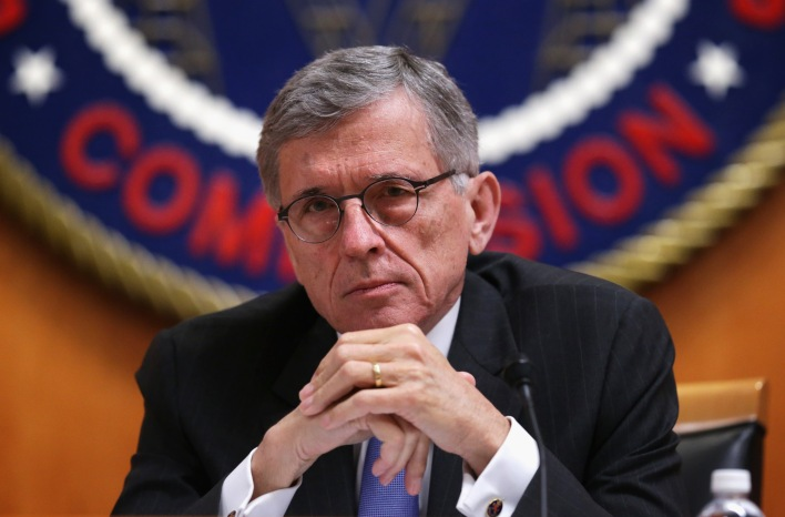 Federal Communications Commission (FCC) Chairman Tom Wheeler listens during an open meeting to receive public comment on proposed open Internet notice of proposed rulemaking and spectrum auctions May 15, 2014 at the FCC headquarters in Washington, DC. The FCC has voted in favor of a proposal to reform net neutrality and could allow Internet service providers to charge for faster and higher-quality service. (Photo by Alex Wong/Getty Images)