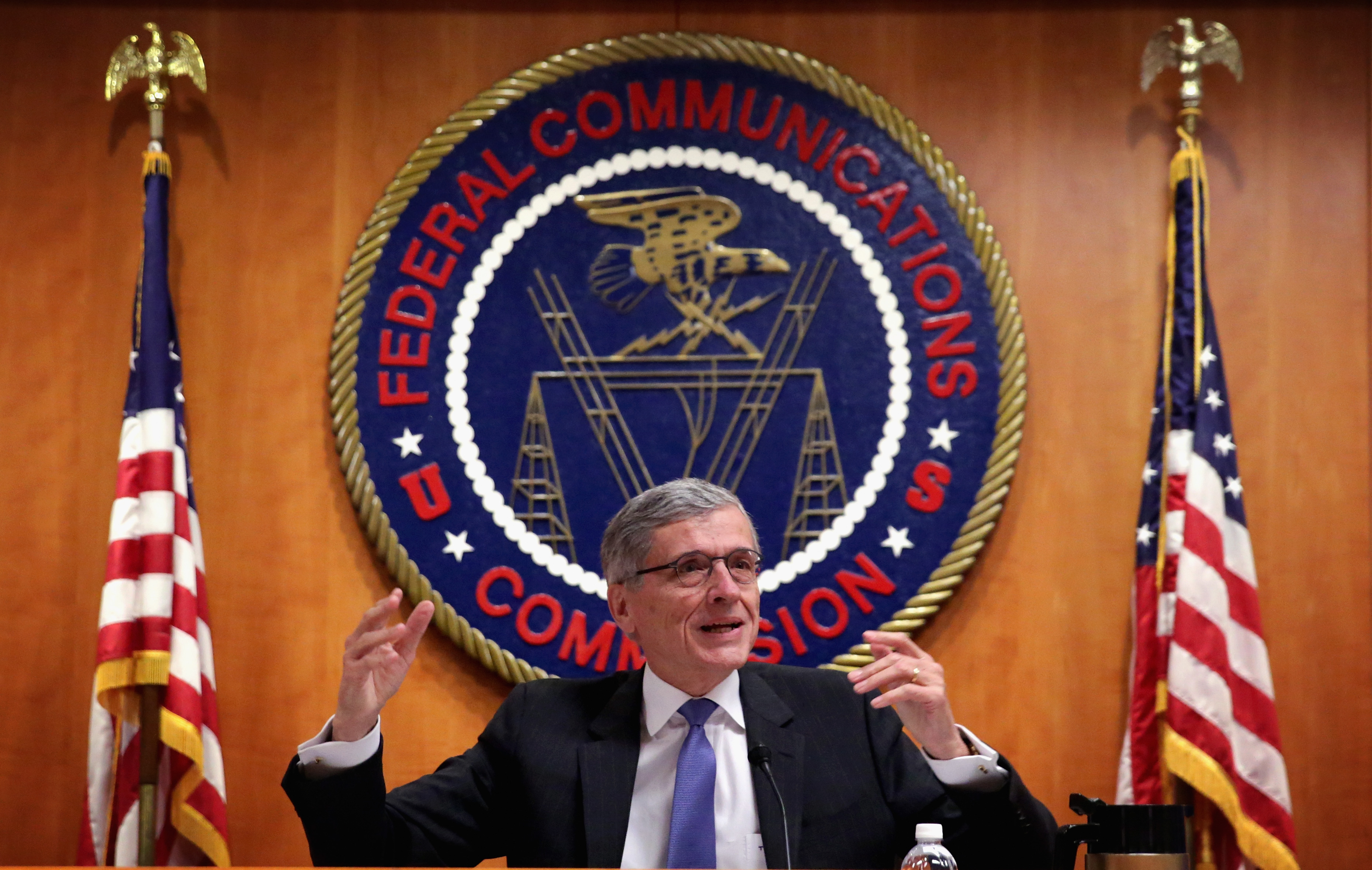 Federal Communications Commission (FCC) Chairman Tom Wheeler speaks during an open meeting to receive public comment on proposed open Internet notice of proposed rulemaking and spectrum auctions May 15, 2014 at the FCC headquarters in Washington, DC. The FCC has voted in favor of a proposal to reform net neutrality and could allow Internet service providers to charge for faster and higher-quality service. (Photo by Alex Wong/Getty Images)