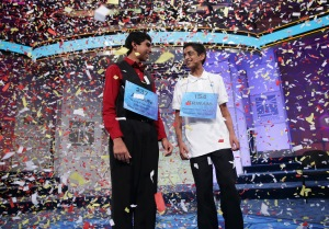 Confetti falls after Sriram Hathwar (R) of Painted Post, New York and Ansun Sujoe (L) of Fort Worth, Texas both won the 2014 Scripps National Spelling Bee competition May 29, 2014 in National Harbor, Maryland. Hathwar and Sujoe were declared as co-champions after 22 rounds of the competition.  (Photo by Alex Wong/Getty Images)